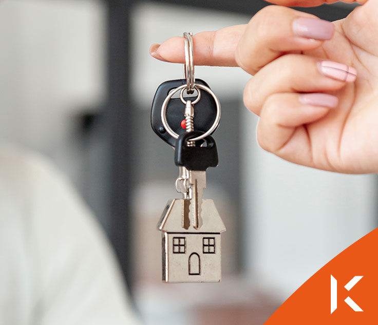 Real estate agent with house model and keys